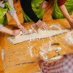 Group of people kneading dough