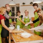 Group of people filing dough